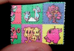 1280px-Pink_Elephants_on_Parade_Blotter_LSD_Dumbo.jpg