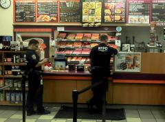 Cops_in_a_Donut_Shop_2011_Shankbone.jpg
