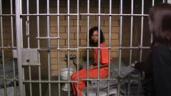 Female_prisoner_shackled_in_her_small_cell.jpg