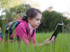 Daily Aug 9 child reading
