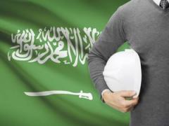 Saudi flag with workman