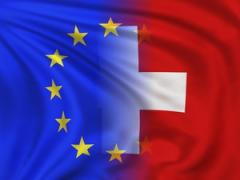 European Union flag and the Swiss flag