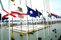 the-us-flag-and-state-flags-line-the-edge-of-the-first-part-of-the-ship-during-c0d8ec-1600.jpg